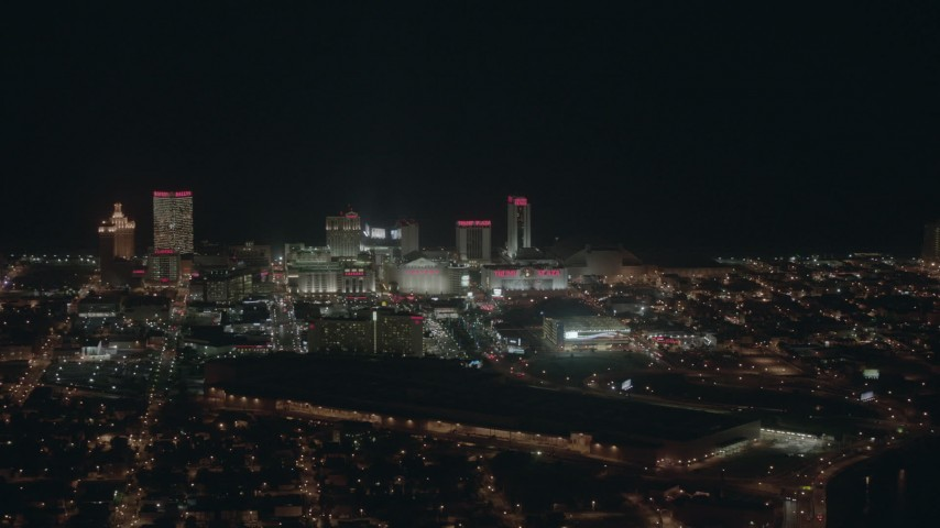 HD stock footage aerial video of panning to reveal hotels and casinos at night, Atlantic City, New Jersey Aerial Stock Footage | PP003_011