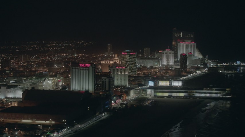 HD aerial video of beachfront hotels and casinos at night in Atlantic City, New Jersey Aerial Stock Footage | PP003_019