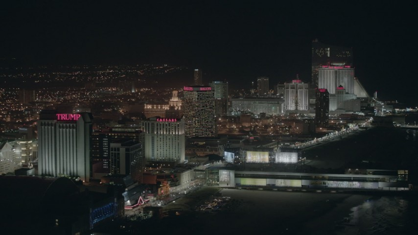 HD stock footage aerial video of several beachside hotels and casinos at night in Atlantic City, New Jersey Aerial Stock Footage | PP003_020