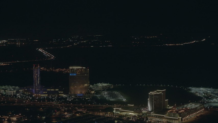 HD stock footage aerial video pan across hotels, casinos, and city sprawl at night in Atlantic City, New Jersey Aerial Stock Footage | PP003_027
