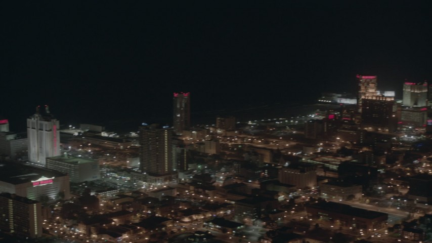 HD stock footage aerial video pan across hotels and casinos on the shore at night in Atlantic City, New Jersey Aerial Stock Footage | PP003_028