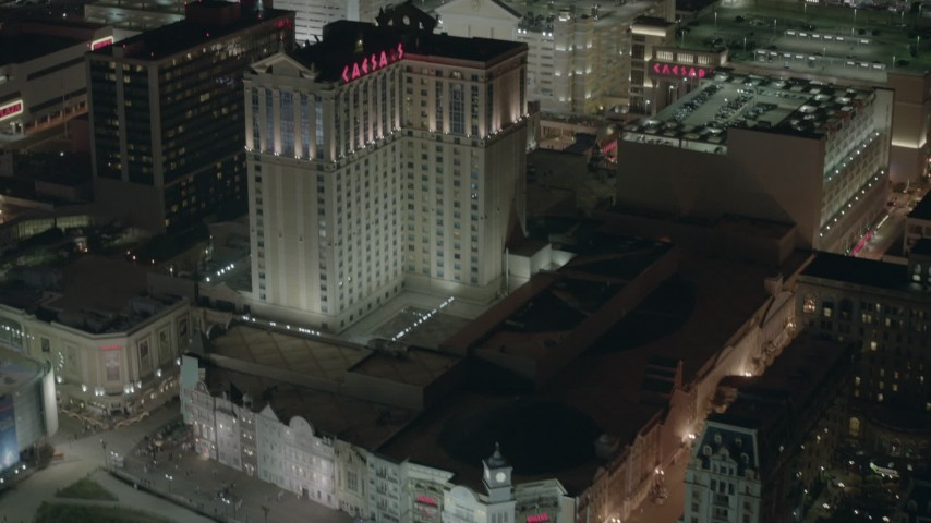 HD stock footage aerial video of tilting from the boardwalk to hotels and casinos at night in Atlantic City, New Jersey Aerial Stock Footage | PP003_032