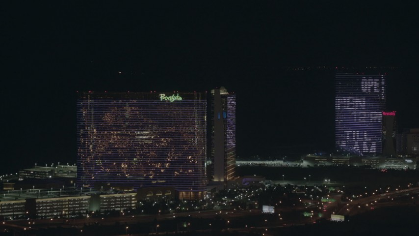 HD stock footage aerial video pan across hotels and casinos at night, Atlantic City, New Jersey Aerial Stock Footage | PP003_033