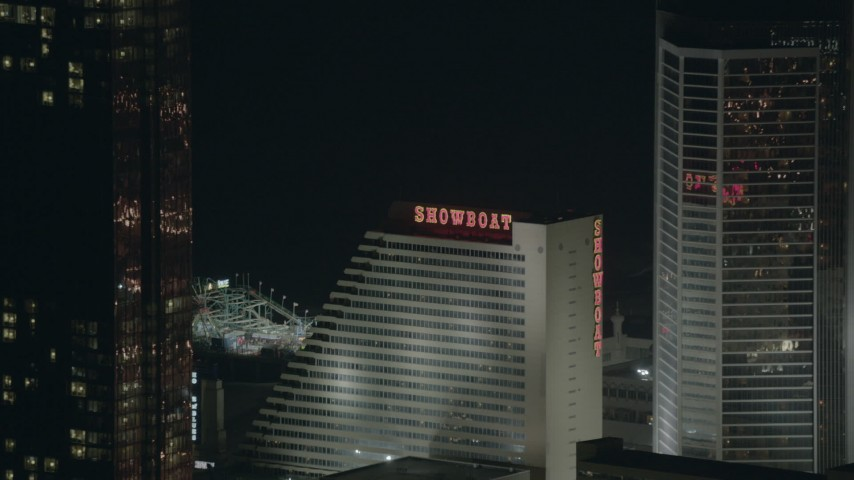 HD stock footage aerial video of Showboat hotel and casino at night in Atlantic City, New Jersey Aerial Stock Footage | PP003_038