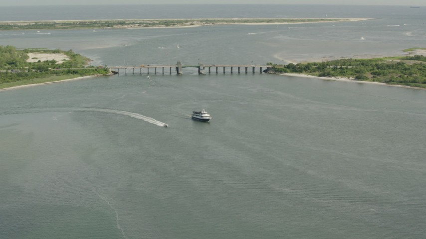 HD stock footage aerial video of approaching a ferry and a bridge in Point Lookout, New York Aerial Stock Footage | PP003_047