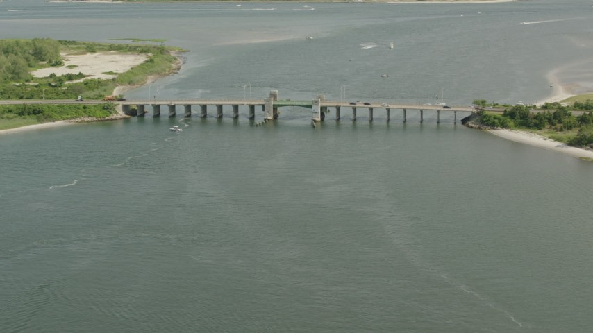 HD stock footage aerial video of approaching a bridge and panning across the water in Point Lookout, New York Aerial Stock Footage | PP003_048