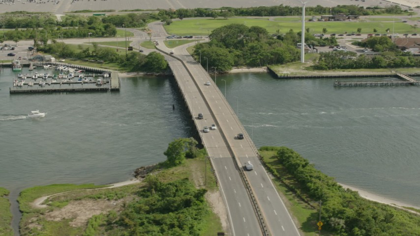 HD stock footage aerial video flyby bridge spanning a river in Point Lookout, New York Aerial Stock Footage | PP003_050