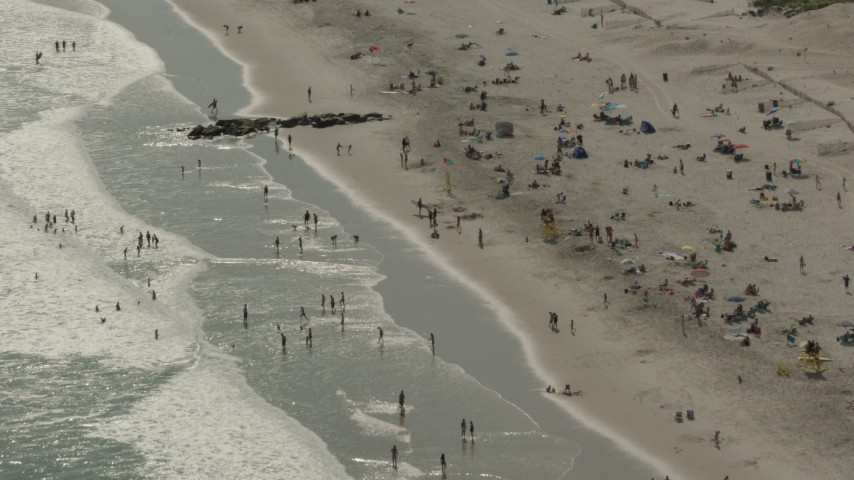 HD stock footage aerial video of approaching sunbathers on the beach, Long Beach, New York Aerial Stock Footage | PP003_053