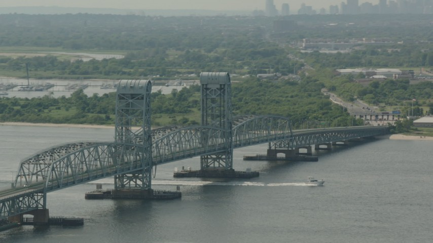 HD stock footage aerial video of tilting from a bridge to reveal the Lower Manhattan skyline, Breezy Point, New York Aerial Stock Footage PP003_057