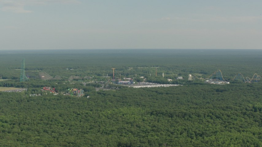 HD stock footage aerial video of rides at the Six Flags Great Adventure theme park in Jackson, New Jersey Aerial Stock Footage | PP003_065