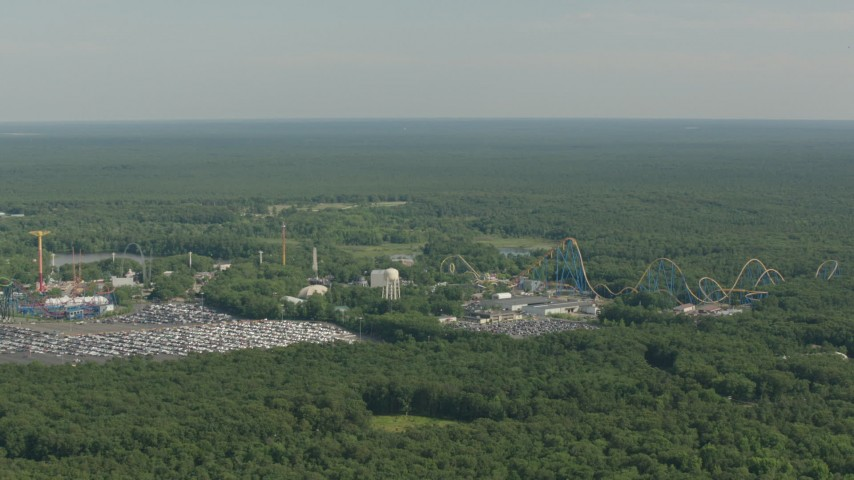 HD stock footage aerial video of flying by rides and roller coaster at Six Flags Great Adventure theme park, Jackson, New Jersey Aerial Stock Footage | PP003_066