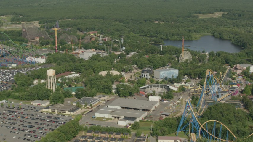 HD stock footage aerial video pass rides and a roller coaster at Six Flags Great Adventure theme park in Jackson, New Jersey Aerial Stock Footage | PP003_068