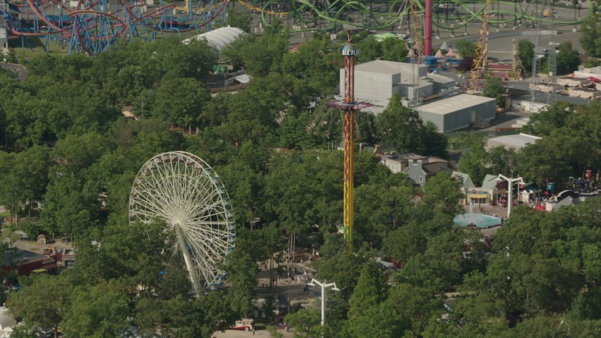 HD stock footage aerial video of a Ferris wheel and rides at Six Flags Great Adventure theme park in Jackson, New Jersey Aerial Stock Footage | PP003_070