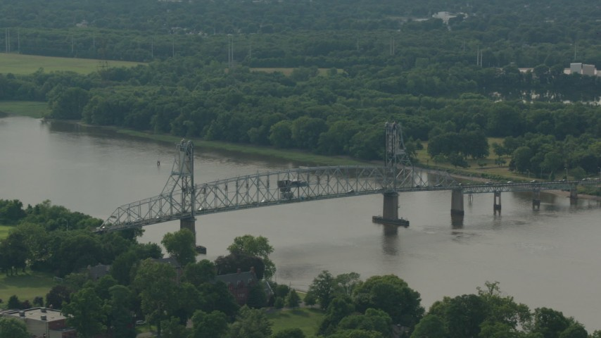 HD stock footage aerial video of flying by the Burlington-Bristol Bridge spanning a river in Burlington, New Jersey Aerial Stock Footage | PP003_081