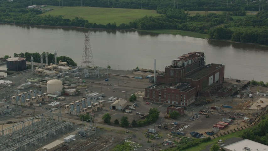 HD stock footage aerial video of passing a riverfront power plant in Burlington, New Jersey Aerial Stock Footage | PP003_082