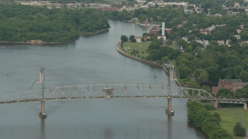 HD stock footage aerial video of flying by the Burlington-Bristol Bridge and river in Burlington, New Jersey Aerial Stock Footage | PP003_084