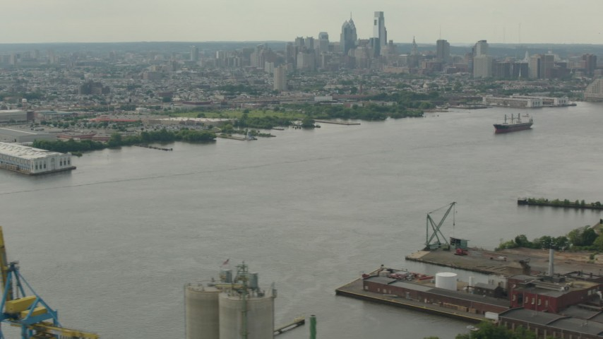 HD stock footage aerial video of the city's skyscrapers and skyline seen from the river, Downtown Philadelphia, Pennsylvania Aerial Stock Footage | PP003_088