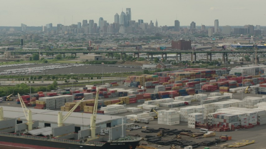 HD stock footage aerial video of the Downtown Philadelphia skyline seen while passing containers at a shipping port, Pennsylvania Aerial Stock Footage | PP003_092
