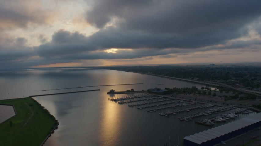 4K stock footage aerial video of Lake Pontchartrain and a marina at sunrise, New Orleans, Louisiana Aerial Stock Footage | PVED01_001