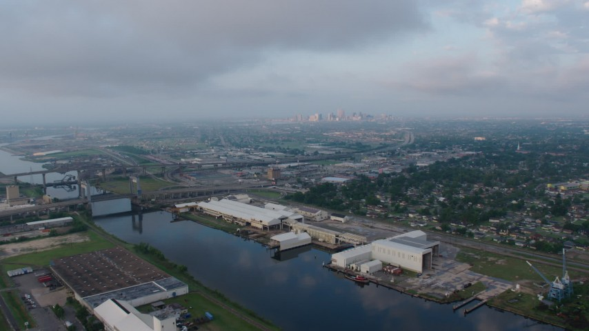 4K stock footage aerial video of Industrial Canal in Upper Ninth Ward at sunrise, New Orleans, Louisiana Aerial Stock Footage | PVED01_002