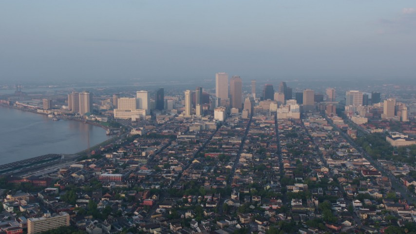 4K stock footage aerial video of fly over French Quarter to approach Downtown at sunrise, New Orleans, Louisiana Aerial Stock Footage | PVED01_005