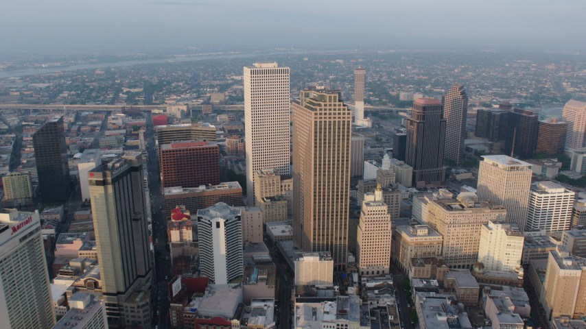 4K aerial video tilt from French Quarter to approach Downtown New Orleans, Louisiana at sunrise Aerial Stock Footage | PVED01_007