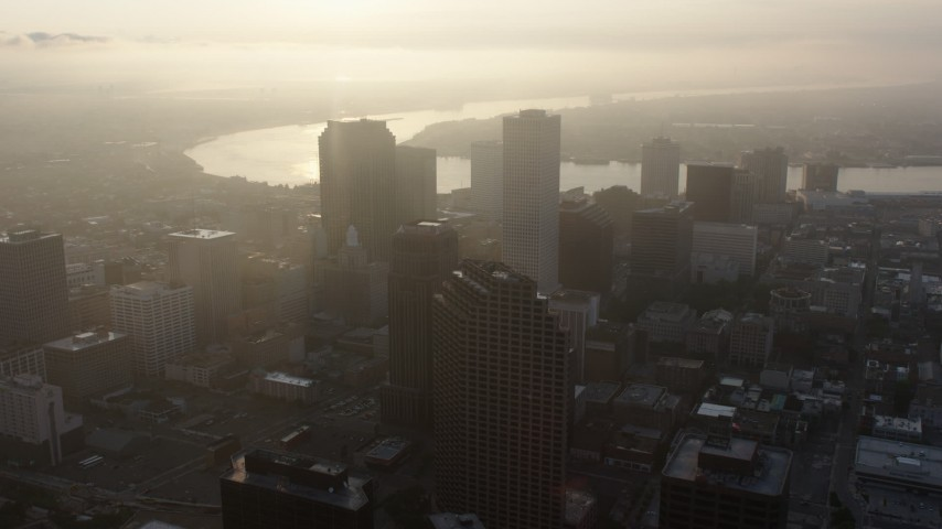 4K stock footage aerial video fly over Downtown New Orleans toward the Mississippi River at sunrise, Louisiana Aerial Stock Footage | PVED01_010