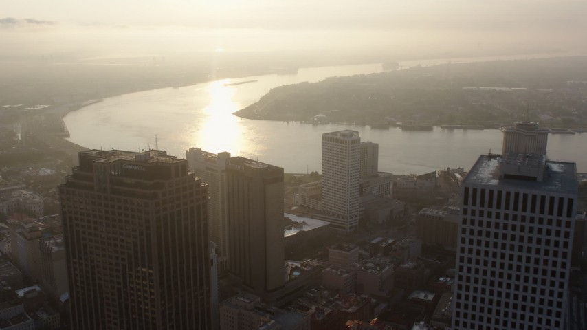 4K aerial video fly over Downtown New Orleans and approach Mississippi River at sunrise, Louisiana Aerial Stock Footage | PVED01_011