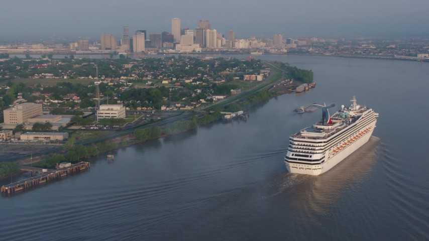 4K aerial video of a Carnival Cruise ship sailing the Mississippi River near Downtown New Orleans, Louisiana at sunrise Aerial Stock Footage PVED01_014