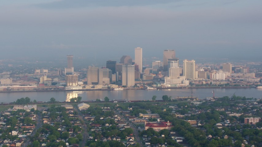 4K stock footage aerial video of Downtown New Orleans skyline seen from across the Mississippi River at sunset, Louisiana Aerial Stock Footage PVED01_015