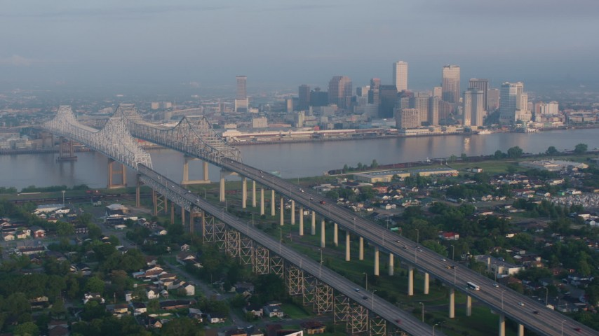 4K stock footage aerial video orbit Crescent City Connection Bridge and Downtown New Orleans at sunrise, Louisiana Aerial Stock Footage | PVED01_016