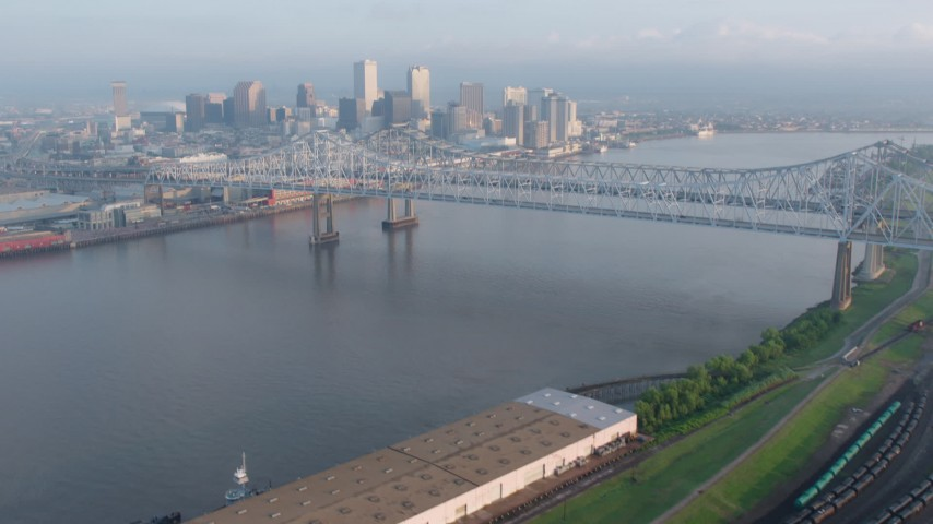 4K stock footage aerial video tilt to reveal Crescent City Connection and Downtown New Orleans at sunrise, Louisiana Aerial Stock Footage | PVED01_018