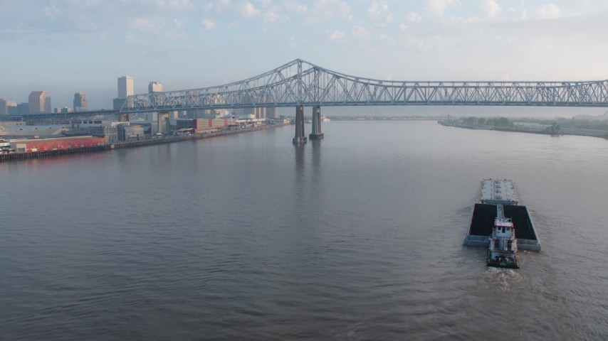 4K aerial video of the Crescent City Connection, reveal Downtown New Orleans at sunrise, Louisiana Aerial Stock Footage | PVED01_021