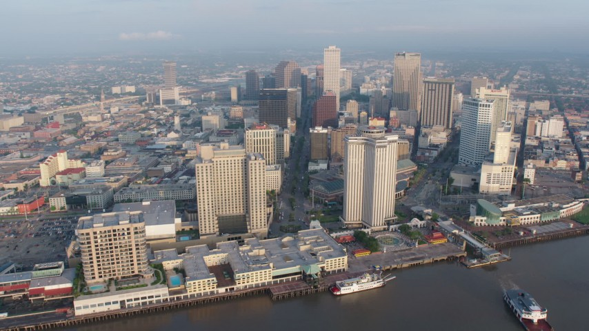 4K aerial video fly over Mississippi River to approach Downtown New Orleans at sunrise, Louisiana Aerial Stock Footage | PVED01_023
