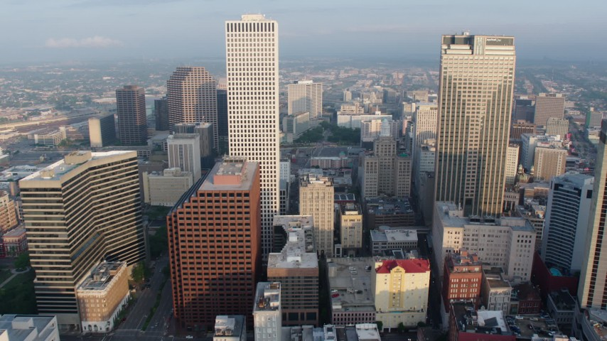 4K stock footage aerial video fly between One Shell Square and Place St. Charles in Downtown New Orleans at sunrise, Louisiana Aerial Stock Footage | PVED01_024