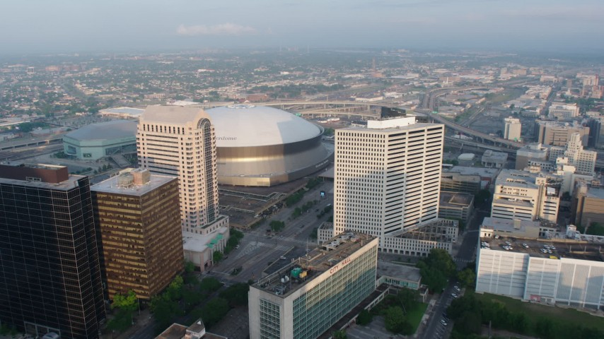 4K aerial video of Downtown New Orleans and City Hall, approach the Superdome at sunrise, Louisiana Aerial Stock Footage | PVED01_025