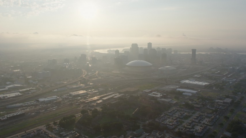 4K stock footage aerial video approach Superdome and Downtown New Orleans from Mid-City at sunrise, Louisiana Aerial Stock Footage | PVED01_026