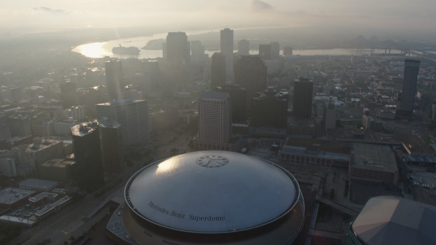 4K stock footage aerial video tilt to reveal and the Superdome in Downtown New Orleans at sunrise, Louisiana Aerial Stock Footage | PVED01_027