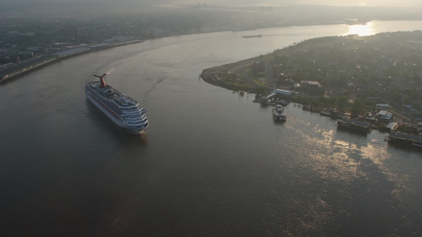 4K stock footage aerial video Carnival Cruise ship sailing the Mississippi River at sunrise, New Orleans, Louisiana Aerial Stock Footage | PVED01_029
