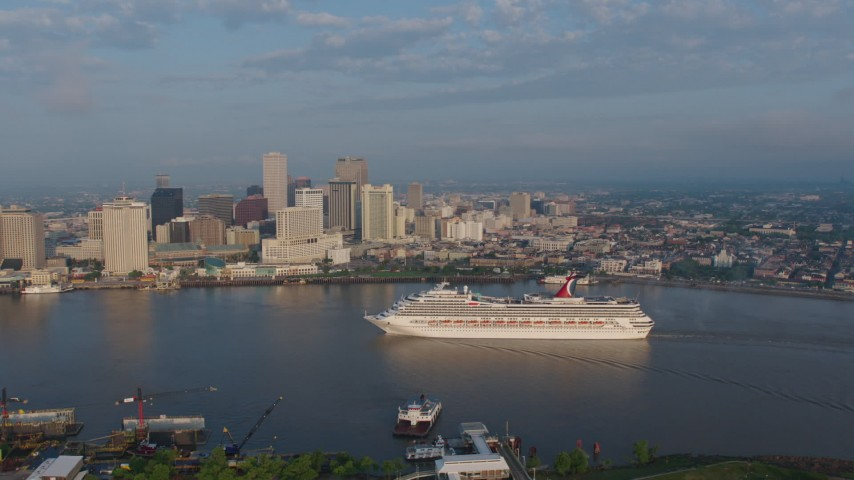 4K aerial video Carnival Cruise ship on the river to reveal Downtown New Orleans at sunrise, Louisiana Aerial Stock Footage | PVED01_030