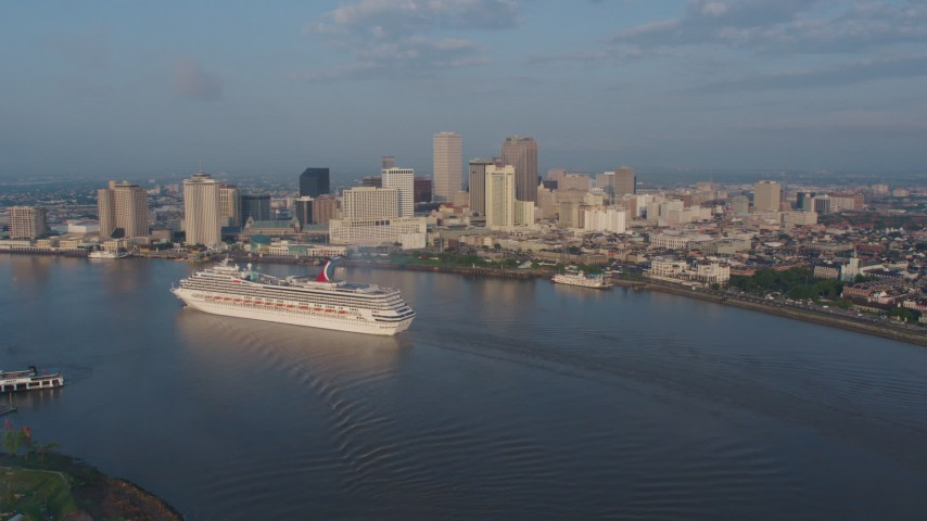 4K stock footage aerial video of a Carnival Cruise ship on the river by Downtown New Orleans at sunrise, Louisiana Aerial Stock Footage | PVED01_031