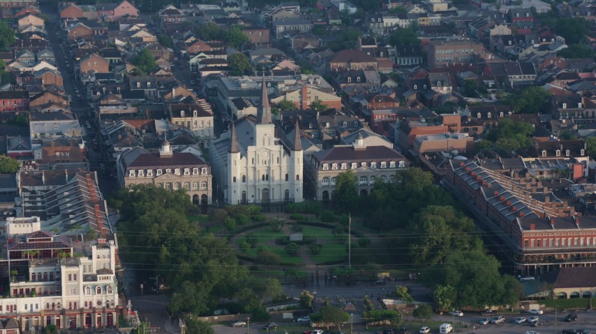 4K aerial video reverse view of St. Louis Cathedral and Jackson Square in the French Quarter of New Orleans at sunrise, Louisiana Aerial Stock Footage | PVED01_035