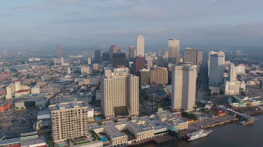 4K aerial video of Downtown New Orleans seen from the Mississippi River at sunrise, Louisiana Aerial Stock Footage | PVED01_036