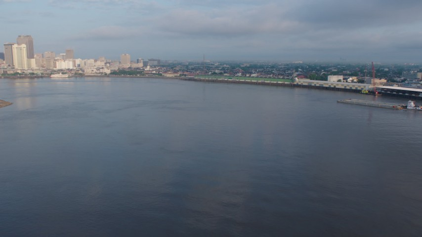 4K aerial video fly low over the Mississippi River toward French Quarter docks at sunrise, Louisiana Aerial Stock Footage | PVED01_038