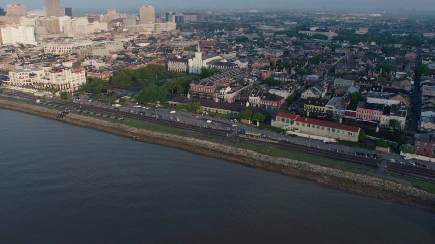 4K stock footage aerial video fly over St. Louis Cathedral and Jackson Square in the French Quarter at sunrise, New Orleans, Louisiana Aerial Stock Footage | PVED01_039