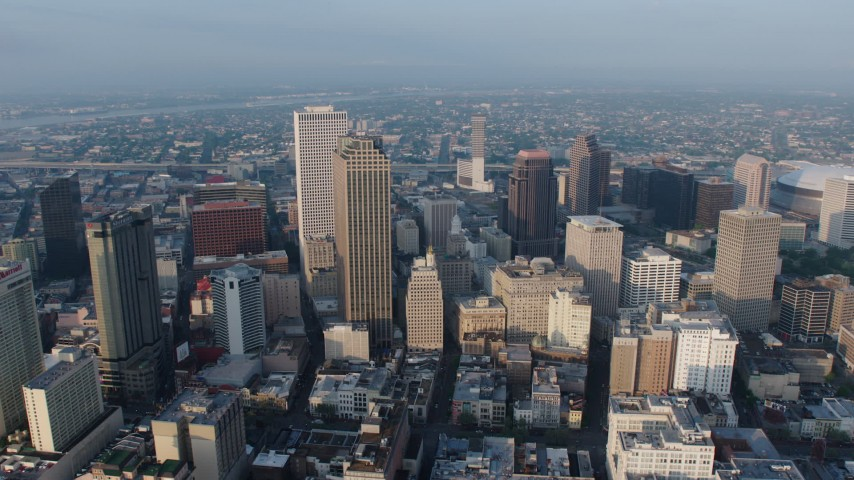 4K stock footage aerial video orbit tall skyscrapers in Downtown New Orleans, Louisiana at sunrise Aerial Stock Footage | PVED01_040