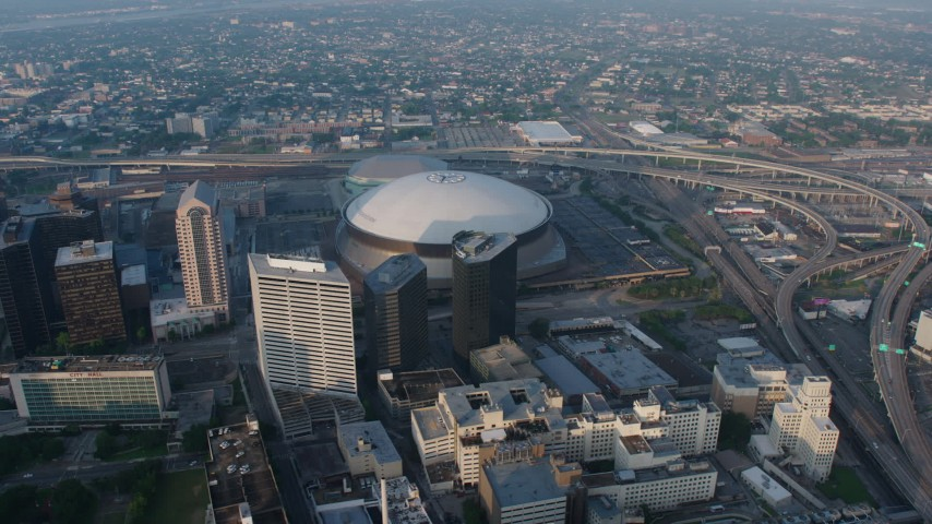 4K stock footage aerial video orbiting the Superdome in Downtown New Orleans, Louisiana at sunrise Aerial Stock Footage | PVED01_041