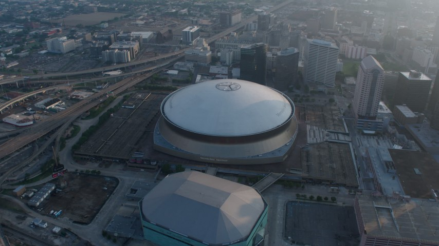 4K stock footage aerial video of the Superdome and New Orleans Arena in Downtown New Orleans, Louisiana at sunrise Aerial Stock Footage | PVED01_043
