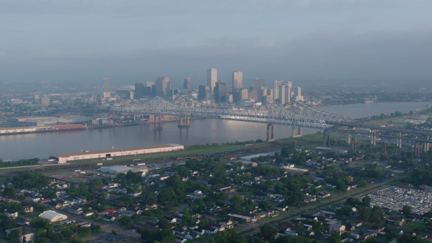 4K aerial video wide orbit of Crescent City Connection and Downtown New Orleans at sunrise seen from Gretna, Louisiana Aerial Stock Footage | PVED01_045