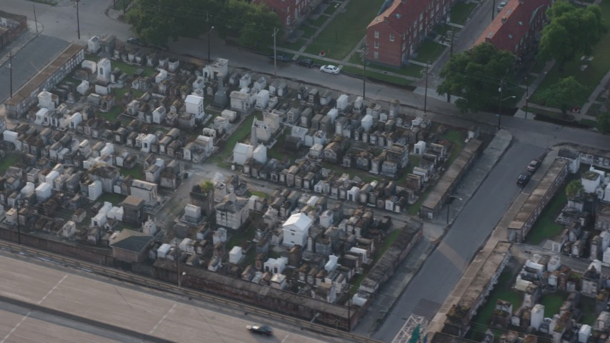 4K stock footage aerial video of two cemeteries in the French Quarter of New Orleans at sunrise, Louisiana Aerial Stock Footage | PVED01_054